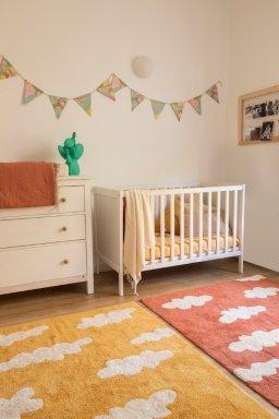 Habitacion de niños con alfombras